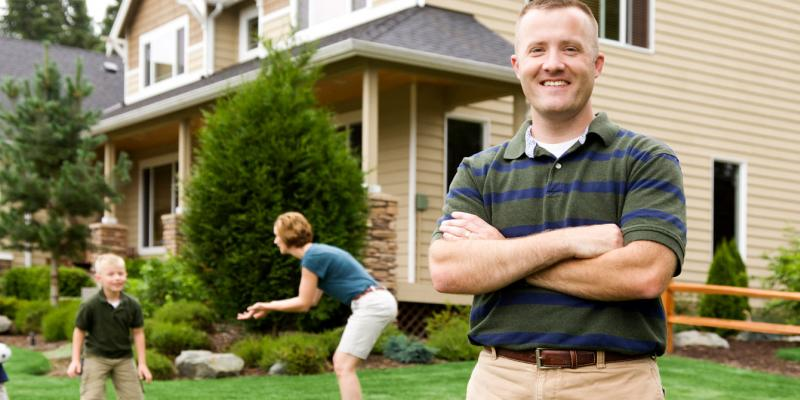 family playing outside after a lawn fertilization service